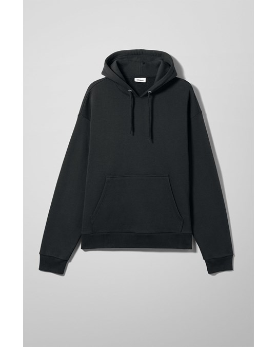 Big Hawk Hoodie Black - The Big Hawk Hoodie is an oversized sweatshirt made from a soft cotton-blend jersey. It has a hood with drawstring closure, a big kangaroo pocket and softly ribbed edges. Size Medium measures 130 cm in chest circumference, 71 cm in length and 65 cm in sleeve length.