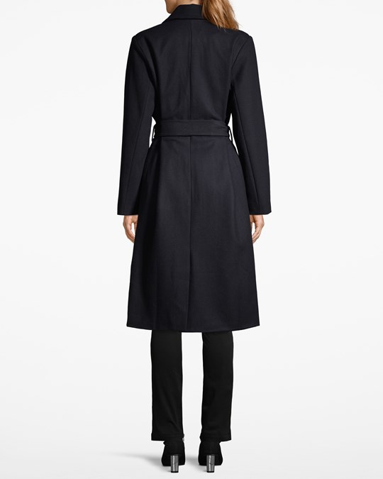 Tina Classic Navy - Woolmix wrap coat. Fully lined. Two pockets in the sideseamd and one inner pocket. Length below knee